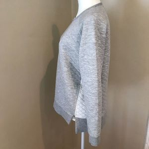Quilted sweatshirt with side slit zips